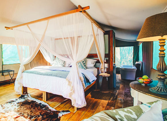 Luxury tented safari suite interior bedroom