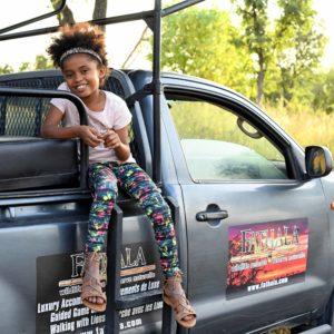 Kids on open vehicle safari drive